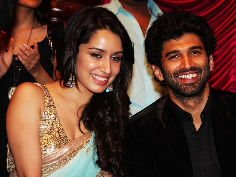 Shraddha Kapoor (L) and Aditya Roy Kapoor attend a soundtrack launch event for the forthcoming Hindi Film