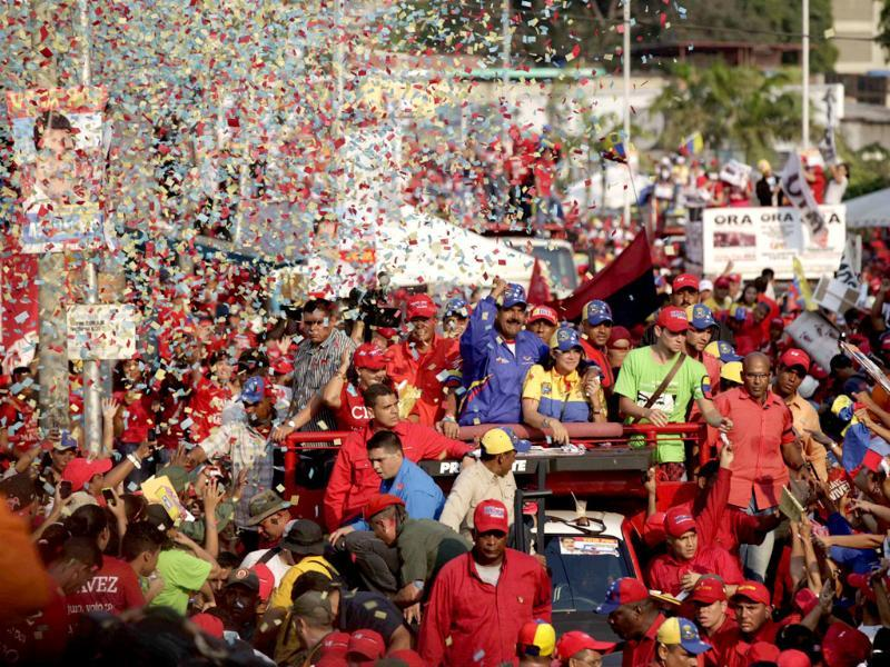 Confetti flies as Venezuela's acting President Nicolas Maduro greets supporters during a campaign rally in Catia La Mar, Venezuela. Maduro, the hand-picked successor of late President Hugo Chavez, is running for president against opposition candidate Henrique Capriles in the Venezuelan presidential election. (AP)