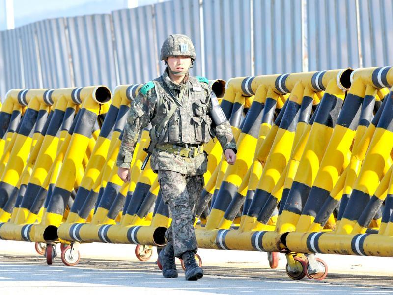 A South Korean soldier walks along barricades on the road leading to North Korea at a military checkpoint in the border city of Paju. South Korea and the United States upgraded their coordinated military surveillance status ahead of an expected mid-range missile launch by North Koreaa, reports said. (AFP)