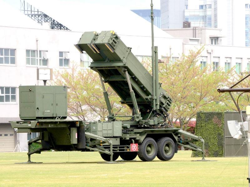 A Japanese soldier walks past a Patriot Advanced Capability-3 (PAC-3) missile launcher deployed at the Defence Ministry in Tokyo. Japan is on full alert ahead of an expected mid-range missile launch by North Korea, its defence minister said, as the UN chief warned of a potentially