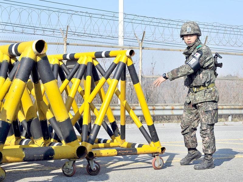 A South Korean soldier sets a barricade on the road leading to North Korea at a military checkpoint in the border city of Paju. South Korea and the United States upgraded their coordinated military surveillance status, a report said, ahead of an expected mid-range missile launch by North Korea. AFP photo