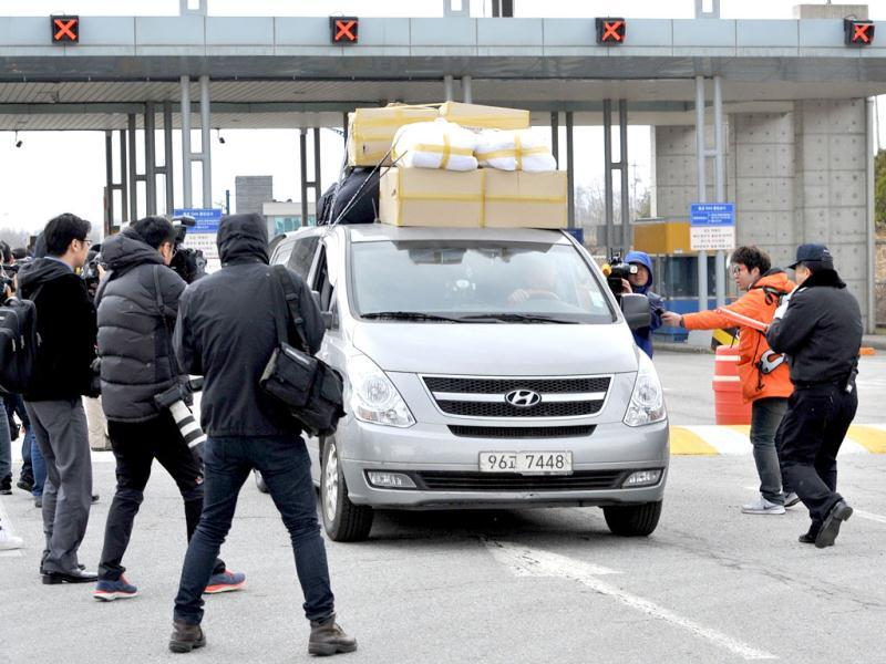 Photographers take pictures of a van arriving from North Korea's Kaesong joint industrial complex, at a gate of the inter-Korean transit office in the border city of Paju. South Korean and US forces raised their alert status to