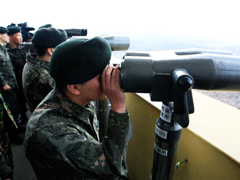 South Korean soldiers look at North Korea through binoculars from Dora Observation Post near the border village of Panmunjom, which has separated the two Koreas since the Korean War, in Paju, north of Seoul, South Korea. AP photo