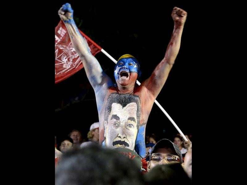 Supporters of Venezuelan acting president Nicolas Maduro cheer during a rally in Barquisimeto. AFP PHOTO/JUAN BARRETO