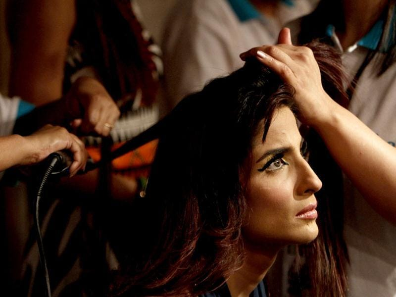A Pakistani model gets ready backstage for the second and last day of Fashion Pakistan Week, in Karachi, Pakistan. The fifth edition of Fashion Pakistan Week was concluded on Wednesday. (AP Photo)