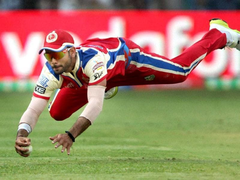 Royal Challengers Bangalore's Virat Kohli dives to stop the ball during T20 match against Kolkata Knight Riders at Chinnaswamy Stadium in Bengalore. (PTI)