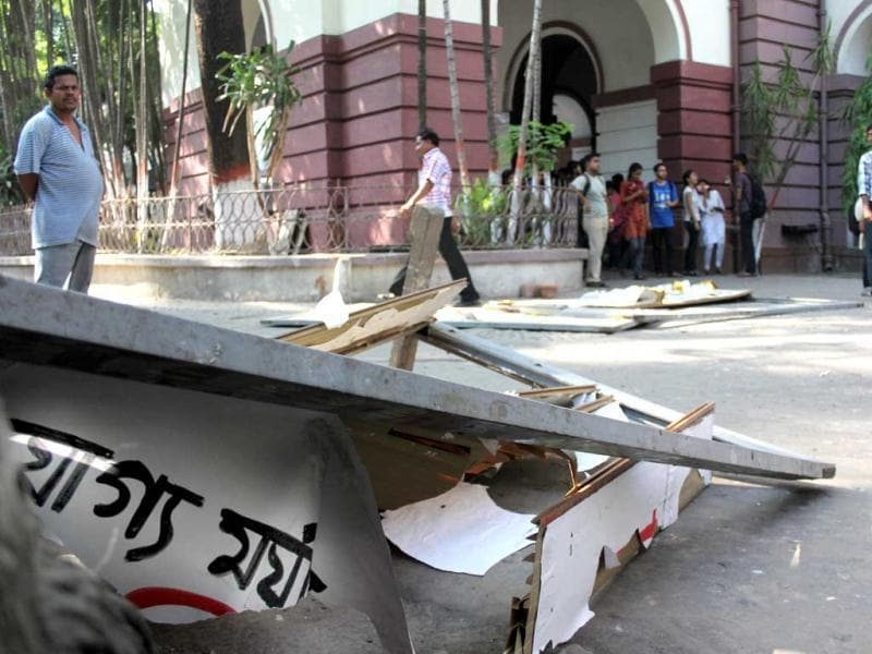 Students walk past the debris left behind after TMC activists ransacked the classrooms and laboratories of the Presidency University campus in Kolkata. HT Photo
