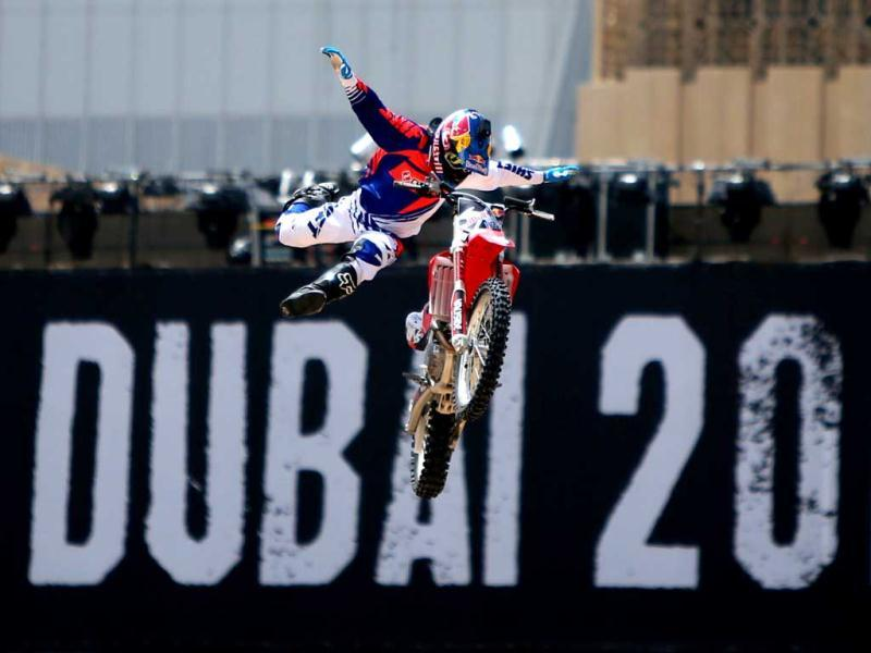 A motocross rider shows his skills during a training session on the eve of the 2013 Red Bull X-Fighters World Tour in the Gulf emirate of Dubai. AFP