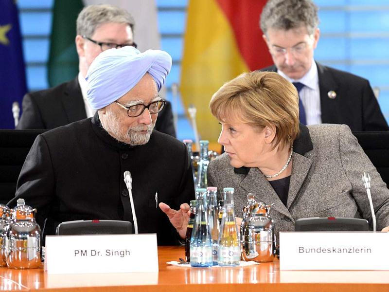 Prime Minister Manmohan Singh and German Chancellor Angela Merkel chat before leading the Indo-German inter-governmental consultations with cabinet and delegation members at the Chancellery in Berlin. AFP photo