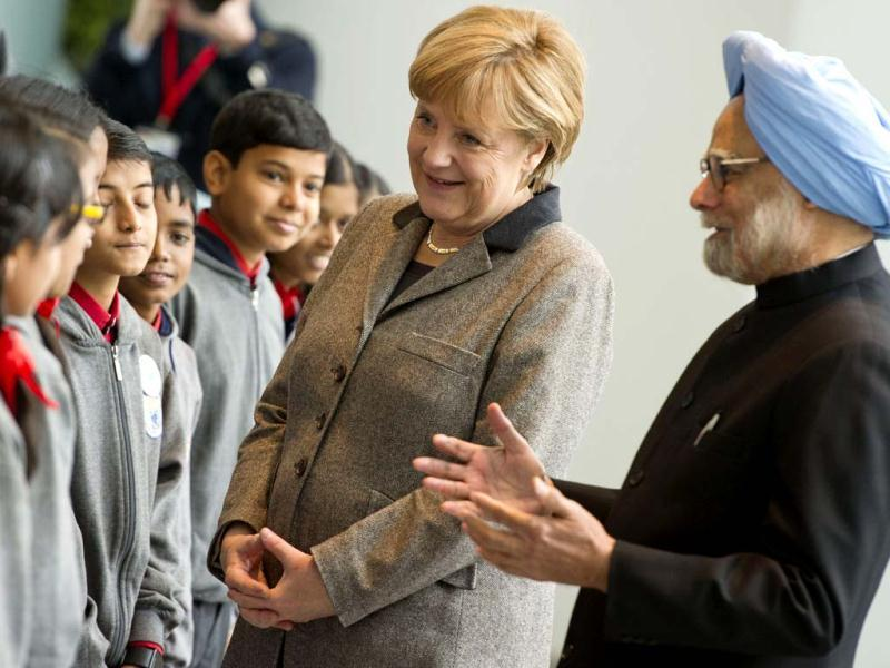 Prime Minister Manmohan Singh and German Chancellor Angela Merkel talk with pupils of an Indian school class at the Chancellery in Berlin. AFP photo