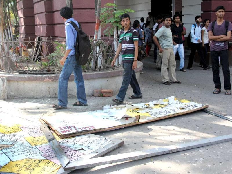 Torn signboards form part of the debris left behind after TMC activists ransacked the classrooms and laboratories of the Presidency University campus in Kolkata. HT Photo