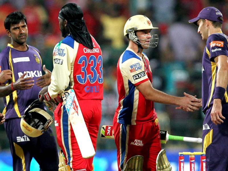 Royal Challengers Bangalore's Chris Gayle and AB De Villiers being congratulated by KKR players after winning the T20 match at Chinnaswamy Stadium in Bengalore. (PTI)