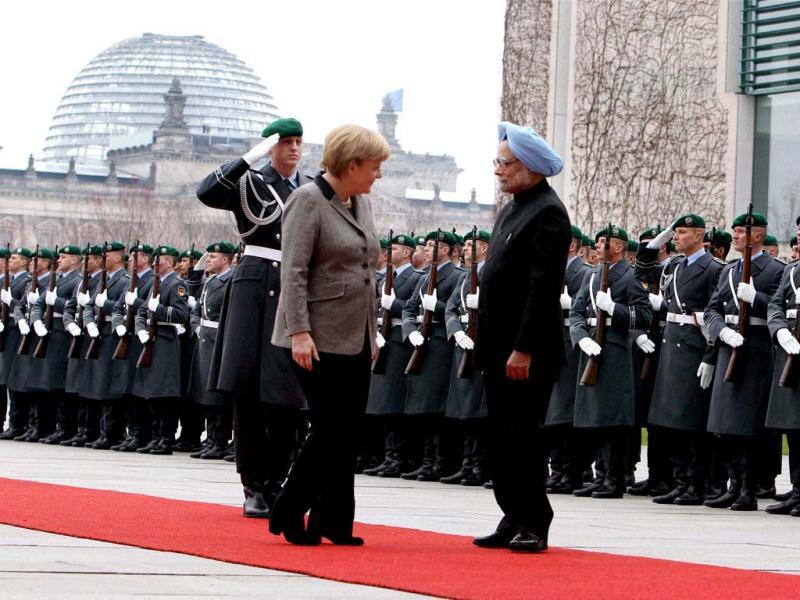 Prime Minister Manmohan Singh with German Chancellor Angela Merkel receive Military honour during an official welcoming ceremony at the Federal Chancellery in Berlin. PTI photo