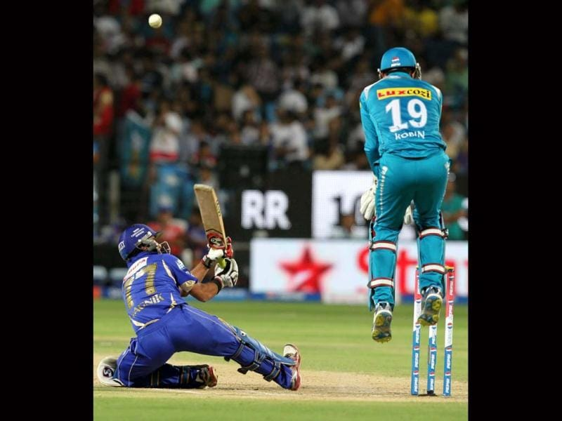 Rajasthan Royals Dishant Yagnik loses his balance as he attempts a scoop and is caught behind during the match against Pune Warriors. PTI Photo