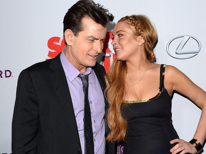 Actors Charlie Sheen (L) and Lindsay Lohan arrive at the Dimension Films' Scary Movie 5 premiere at the ArcLight Cinemas Cinerama Dome in Hollywood, California.  (AFP Photo)