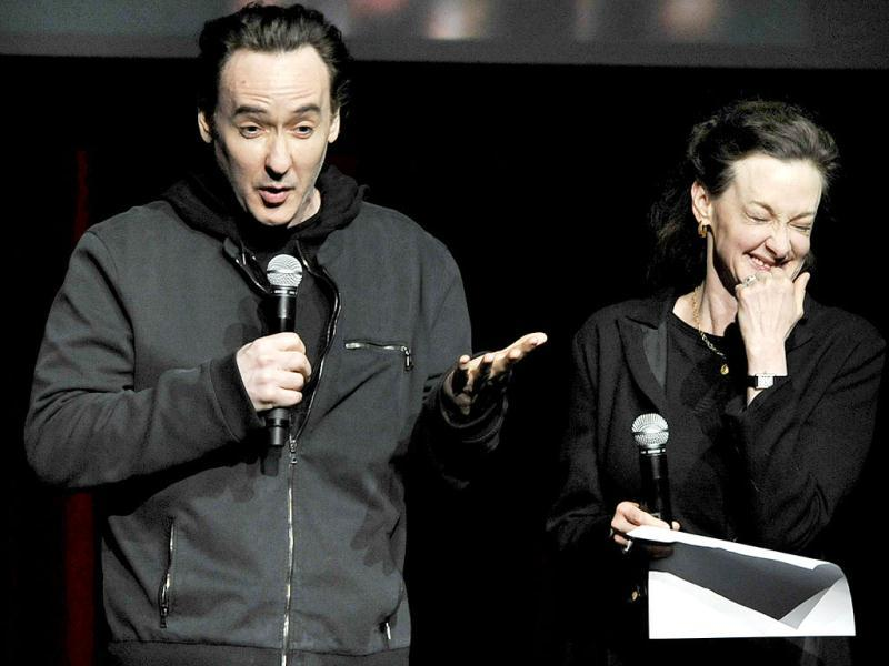 Actors John Cusack (L), and Joan Cusack (R), talk about Roger Ebert during a memorial for the film critic at The Chicago Theater in Chicago. (AP Photo)