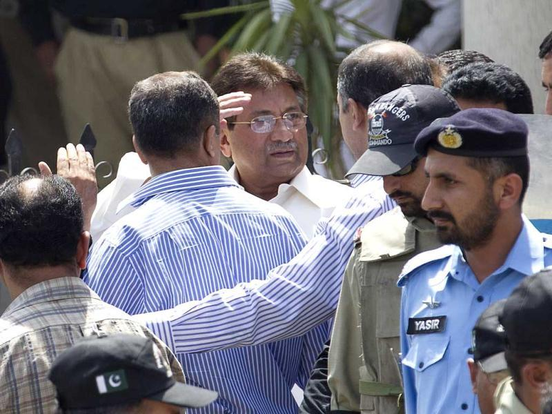 Pakistan's former president Pervez Musharraf gestures as he leaves the high court building in Islamabad. Musharraf appeared in the court during a hearing pertaining to the judges detention case. AP/BK Bangash)