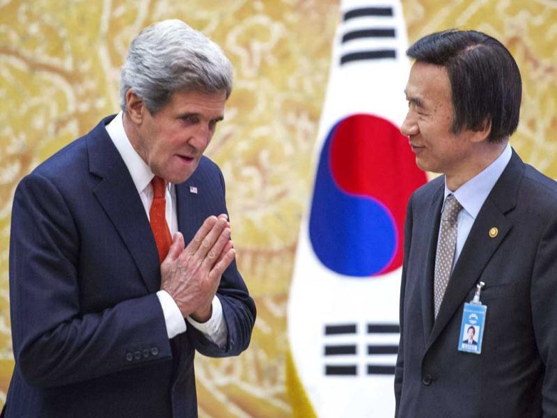 US secretary of state gestures as he meets South Korea's foreign minister Yun Byung-se before the arrival of South Korean's President Park Geun-hye at the presidential Blue House in Seoul. AP/Paul Richard, Pool