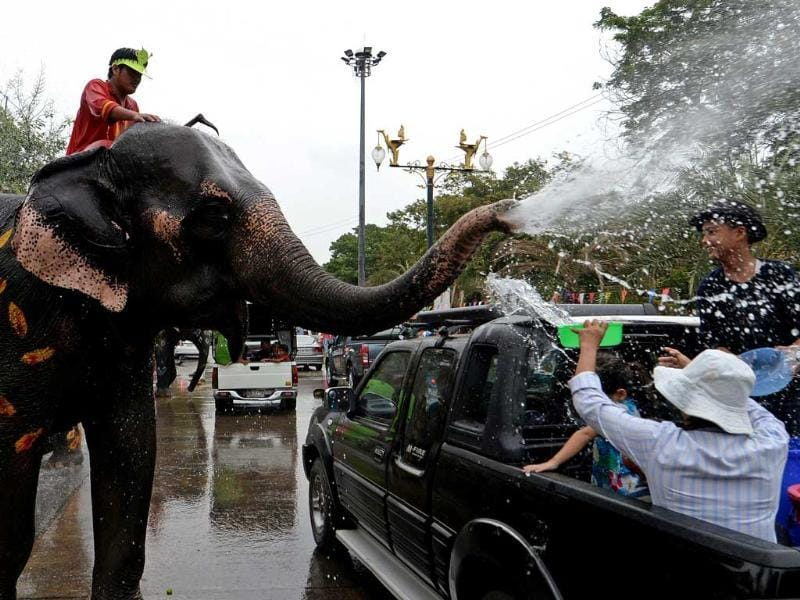 Thai villagers take part in a water battle with elephants as they join celebrations marking the Songkran Festival in Ayutthaya province. Songkran is the Thai New Year and is celebrated by people by splashing water at each other. AFP