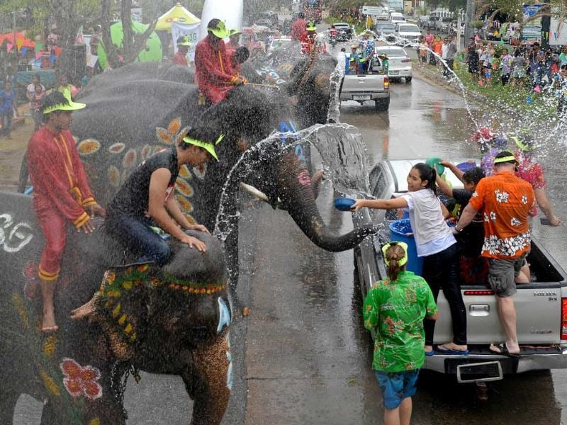 Thai people and foreign tourists take part in water battles with elephants as they join celebrations marking the Songkran Festival in Ayutthaya province. AFP