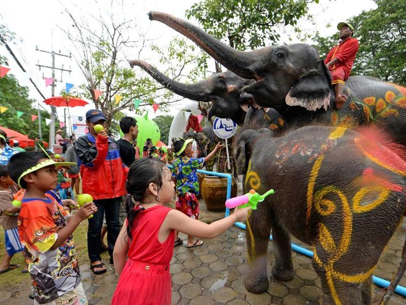 Thai children take part in water battles with elephants as they join celebrations marking the Songkran Festival in Ayutthaya province. AFP