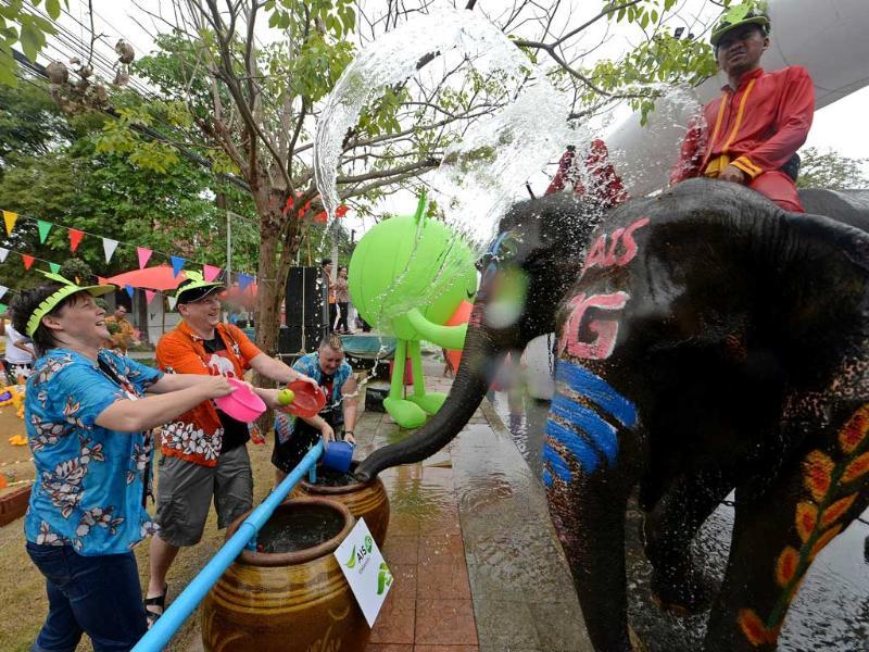 Foreign tourists take part in water battles with elephants as they join celebrations marking the Songkran Festival in Ayutthaya province. Songkran is the Thai New Year. AFP