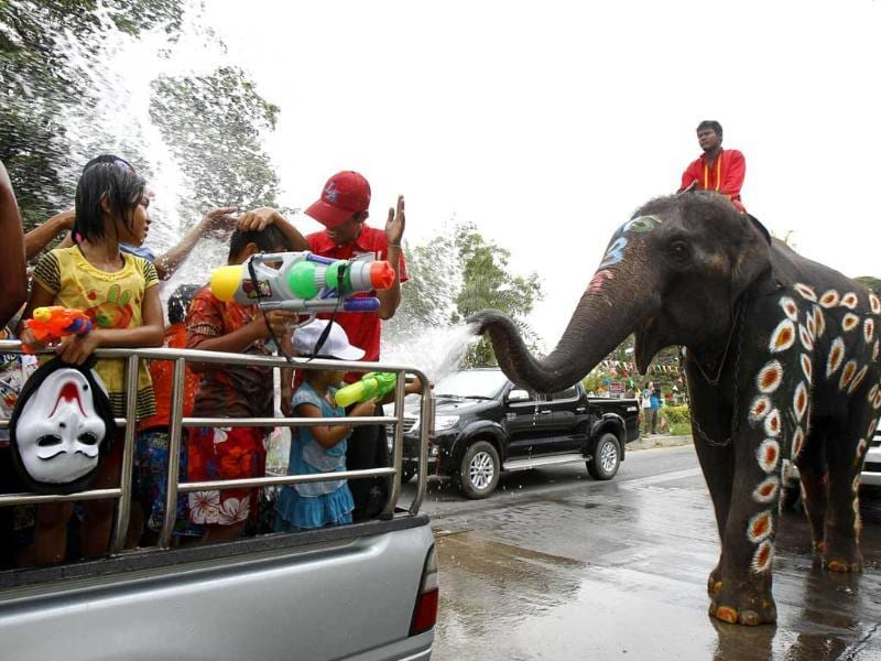 Elephants spray water at children in celebration of the Songkran water festival in Thailand's Ayutthaya province, about 80km north of Bangkok. Reuters
