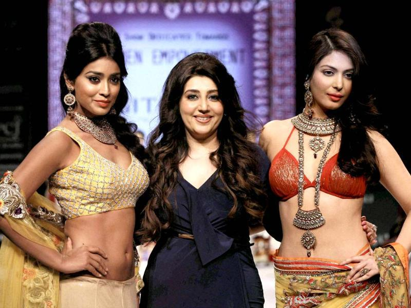 Actress Shriya Saran, the designer and a model at India International Jewellery Week IIJW in New Delhi. PTI Photo