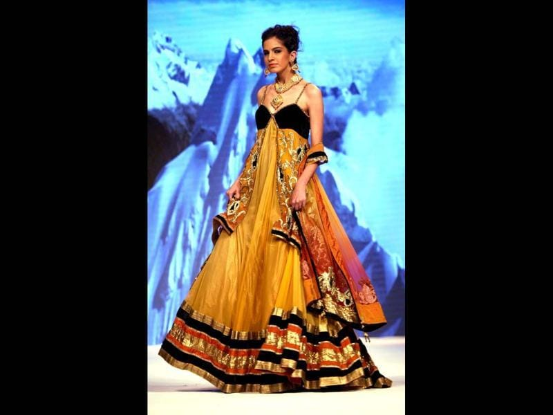 A model walks the ramp at Delhi's first edition of India International Jewellery Week. PTI Photo