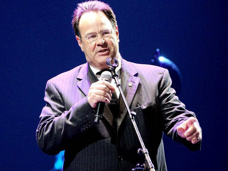 Actor and musician Dan Aykroyd serves as MC at Eric Clapton's Crossroads Guitar Festival 2013 at Madison Square Garden in New York. AP Photo