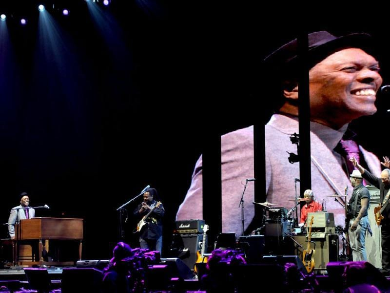 Musician Booker T Jones, left, and band with Steve Cropper, right, on guitar, perform at Eric Clapton's Crossroads Guitar Festival 2013 at Madison Square Garden in New York. AP Photo