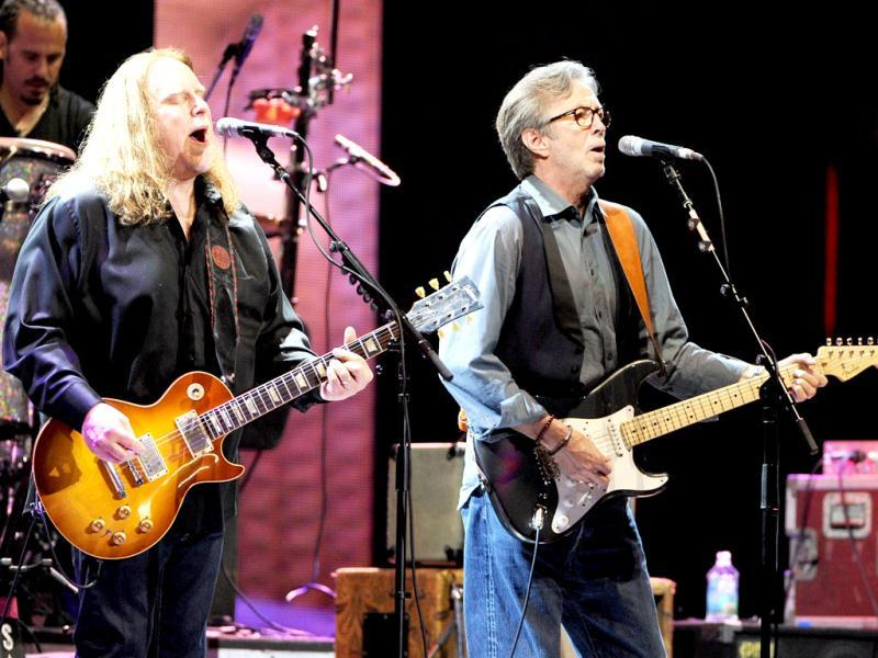 Musician Eric Clapton, right, joins Warren Haynes and The Allman Brothers Band on stage at Eric Clapton's Crossroads Guitar Festival 2013 at Madison Square Garden in New York. AP Photo