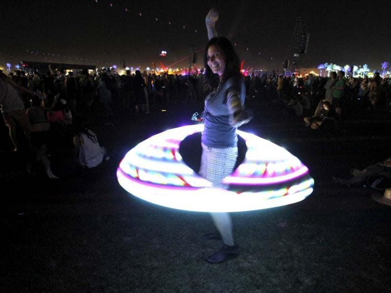 A concert-goer dances using an illuminated hula hoop during the Coachella Music Festival in Indio. (Reuters)