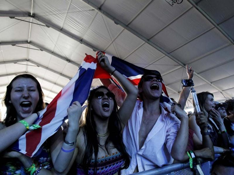 Concert-goers hold a British flag as they watch the band Alt-J perform during the Coachella Music Festival in Indio. (Reuters)