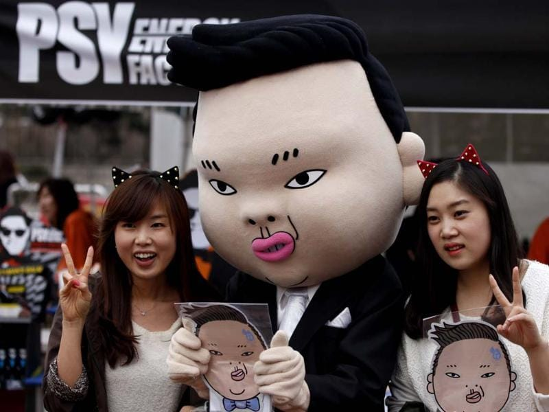 Fans of South Korean rapper Psy take a picture at the Seoul World Cup stadium, the venue for Psy's concert 'Happening' in Seoul. Reuters photo
