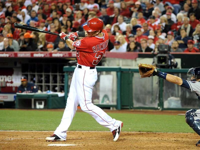 Josh Hamilton #32 of the Los Angeles Angels hits a homerun in the sixth inning against the Houston Astros at Angel Stadium of Anaheim in Anaheim, California. AFP