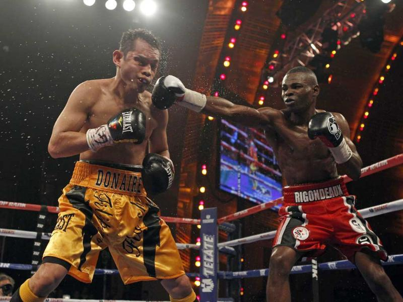 Cuban boxer Guillermo Rigondeaux connects a punch on Nonito Donaire of Philippines during their WBO/WBA junior featherweight title unification fight at Radio City Music Hall in New York. Reuters