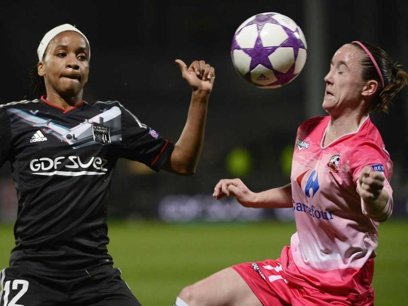 Juvisy's French forward Julie Marchart vies with Lyon's French forward Elodie Thomis during the Champions League women semi-final football match Olympique Lyonnais vs FC Juvisy at the Gerland Stadium in Lyon, central-eastern France. AFP