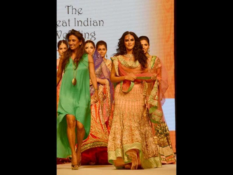 Neha Dhupia walks the ramp along with the designer at the jewellery fair. AFP Photo