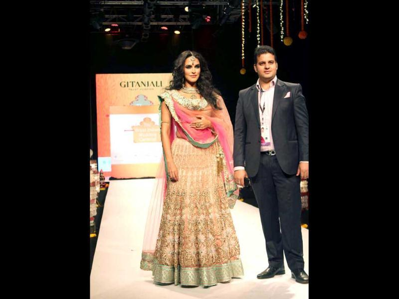 Neha Dhupia launches The Great Indian Wedding Carnival on the Day 2 of IIJW, Delhi along with Sushil Sharma, President, Intaernational Business, Gitanjali Group in Pragati Maidan on Saturday. UNI Photo