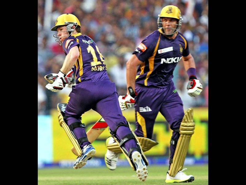 Kolkata Knight Riders batsmen Eoin Morgan and Jacques Kallis cross each other to collect singles during T20 match against Sunrisers Hyderabad in Kolkata. PTI Photo