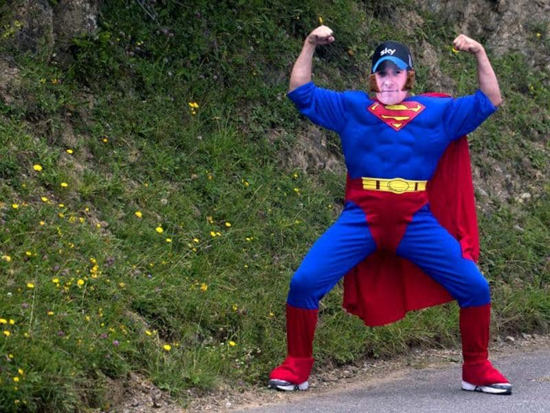 A fan, disguised as Superman character, poses as he waits for the pack in the 143,5 km and seventeenth stage of the 2012 Tour de France cycling race starting in Bagneres-de-Luchon and finishing in the ski resort of Peyragudes, southern France. AFP photo