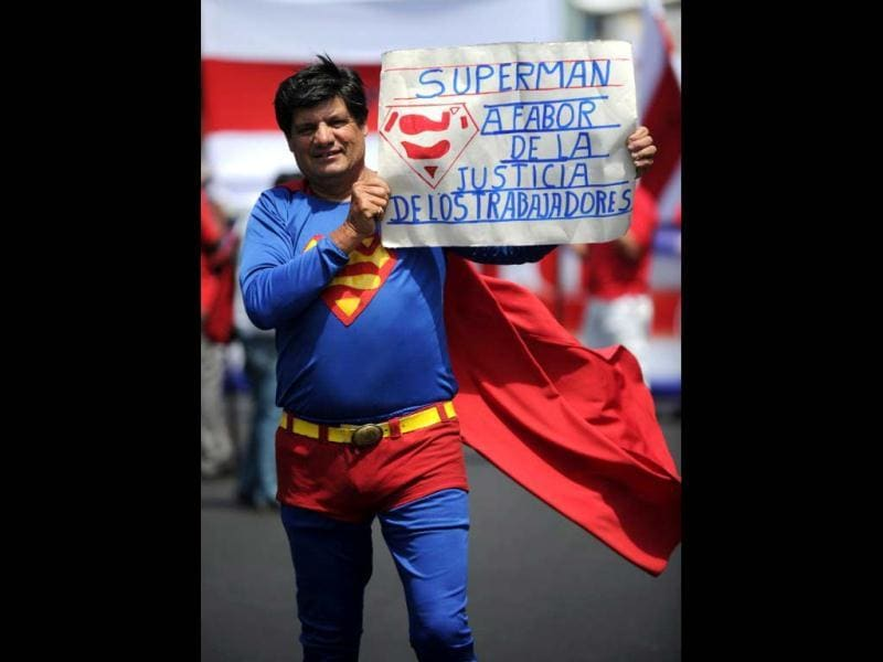A worker dressed as Superman joins members of various labour unions during in a rally on Labour Day in San Jose, Costa Rica. AFP photo