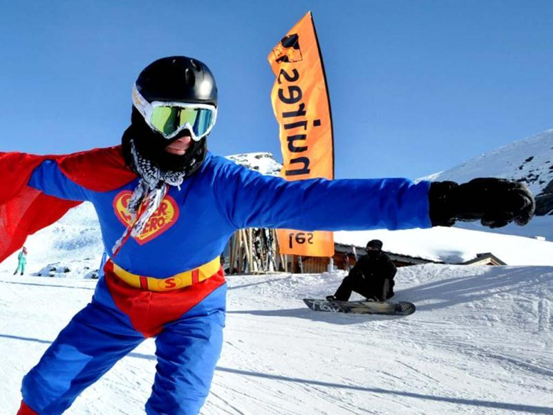 A man dressed in Superman costume rides on the French Alpine slopes at Les Menuires ski resort, eastern France. AFP photo