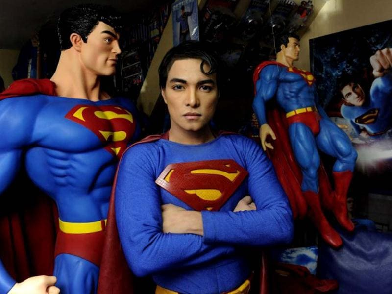 Filipino fashion designer Herbert Chavez stands dressed like comic book hero Superman among his huge collection of memorabilia at his home in Calamba, south of Manila. AFP photo