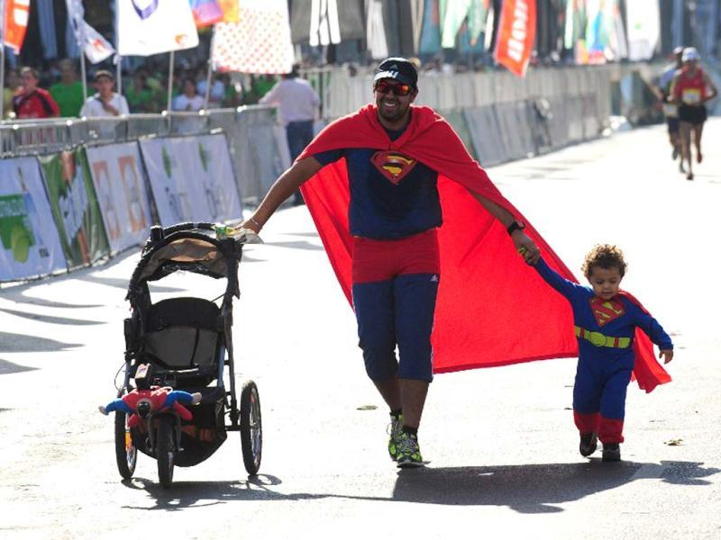 A man and his son, dressed as Superman, take part in the 5th Santiago Marathon, in Santiago. AFP photo