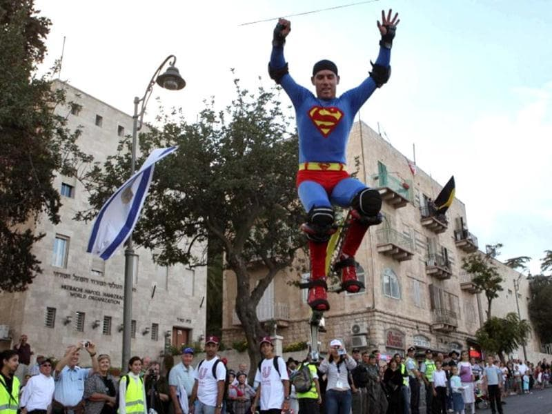 A man dressed as Superman jumps in the air during a parade in celebration of the Jewish holiday of Sukkot, in downtown Jerusalem. AFP photo