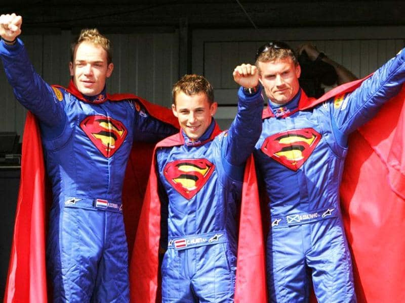 Red Bull drivers Dutch Robert Doornbos, Austrian Christian Klien and Scottish David Coulthard wear Superman costumes in the pits of the Monaco racetrack before the third practice session of the 2006 Formula One Monaco Grand Prix. AFP photo