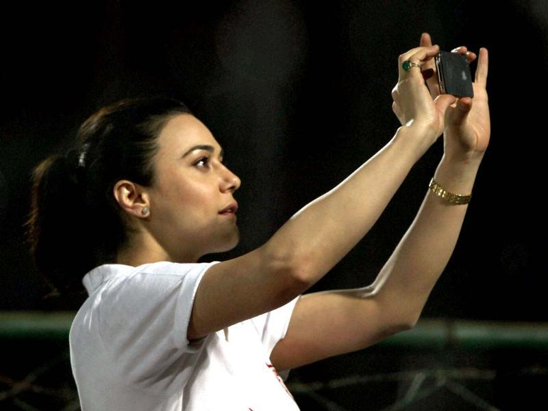 Kings XI Punjab's owner and actress Preity Zinta takes photo during the T20 match against Rajasthan Royals in Jaipur. PTI Photo