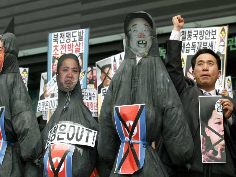 South Korean protesters display effigies of North Korean leader Kim Jong Un and late leaders Kim Jong Il and Kim Il Sung at an anti-North Korea protest on the birthday of Kim Il Sung in Seoul, South Korea. South Korea's defense minister, Kim Kwan-jin, told a parliamentary committee in Seoul on Monday that North Korea remains ready to launch a missile from its east coast, though he declined to disclose how he got the information. (AP)